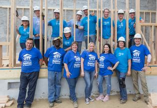Camden County Habitat for Humanity and Subaru volunteers pose after building a new house framework for Camden residents on June 16, 2017.