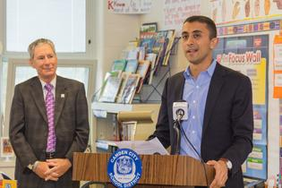 Camden City School District Superintendent Paymon Rouhanifard addresses students, alongside Subaru of America President Tom Doll following the automaker's donation of more than 3,000 science books to Camden schools. Photo credit: Mark Nesbitt courtesy of iNTVNETWORK, LLC 2017.