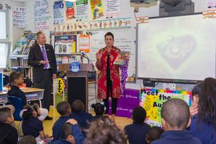 Children's book author Dianne H. Aston reads to Camden third graders, alongside Subaru of America President Tom Doll following the automaker's donation of more than 3,000 science books to Camden schools. Photo credit: Mark Nesbitt courtesy of iNTVNETWORK, LLC 2017.