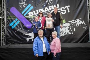 Local wish kid Derek, his family and wish granters at Subaru WinterFest reveal Derek's wish to go to Alaska will be granted.