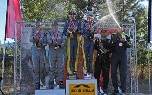 Craig Drew, David Higgins, Per Almkvist and Patrik Sandell celebrate on the Idaho Rally podium, next to third place finisher and Subaru driver Jeff Seehorn and Karen JankowskiPhoto Credit: Matthew Stryker / Subaru Rally Team USA