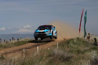 David Higgins and co-driver Craig Drew get airborne at the Oregon Trail Rally. Credit: Mathew Stryker / Subaru Rally Team USA