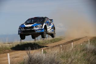 Chris Atkinson and co-driver Stephane Prevot fly high in their Subaru WRX STI rally car at the Oregon Trail Rally. Credit: Mathew Stryker / Subaru Rally Team USA
