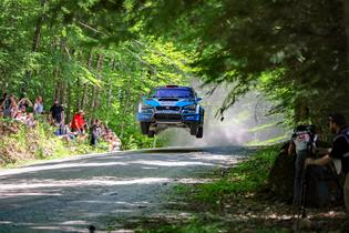 David Higgins and Craig Drew take flight en route to a victory at Oregon Trail RallyPhoto credit: Matthew Stryker