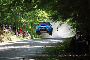 David Higgins catches air at the famous Concord Pond stage of the New England Forest Rally