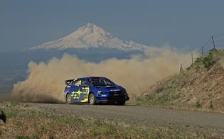 Travis Pastrana and Robbie Durant keep up the pace through Oregon's long, dusty stage roads against the backdrop of Oregon's Mt. Hood.