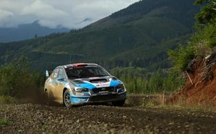 David Higgins and codriver Craig Drew slide their Subaru WRX STI at the Tour de Forest Rally. Credit: Matthew Stryker / Subaru Rally Team USA