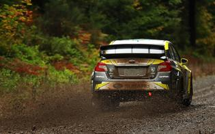 Patrik Sandell blasts down a muddy stage road at the 2018 Tour de Forest Rally. Credit: Matthew Stryker / Subaru Rally Team USA