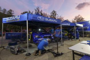 The Subaru Motorsports USA crew works into the night to prepare the two WRX STI rally cars for a long final day of competition at New England Forest Rally.