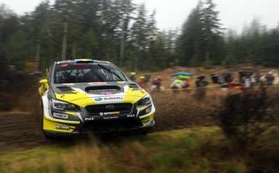 Patrik Sandell slides past a spectator area at the Tour de Forest Rally. Credit:  Matthew Stryker / Subaru Rally Team  USA