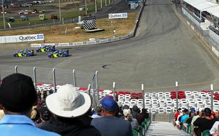 Rallycross fans at Quebec's Grand Prix de Trois-Rivières watch all three Subaru drivers round Turn 1 during Sunday's qualifying heats.