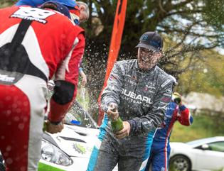SRTUSA Driver David Higgins celebrates his 8th consecutive win at the Oregon Trail Rally