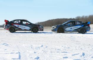 The #199 and #75 Subaru WRX STI rally cars of Pastrana and Higgins