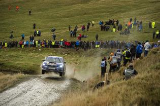 Rally fans endured heavy rain and winds to catch a glimpse of Higgins and Drew at Wales Rally GB.