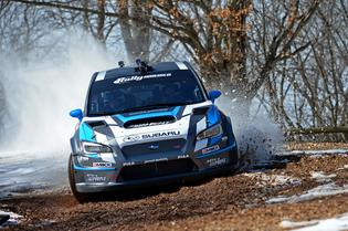 Subaru driver David Higgins attacks the Super Special stage of Rally in the 100 Acre Wood.