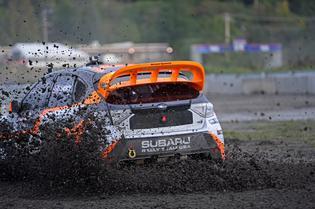 Subaru driver Bucky Lasek slings wet gravel during the Seattle Red Bull GRC event
