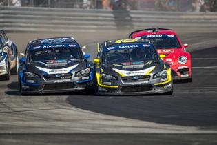 Subaru teammates Chris Atkinson and Patrik Sandell charge into a corner at GRC.