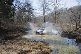 Travis Pastrana stream crossing 100 Acre Wood Rally 2014