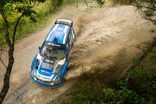 Travis Pastrana and codriver Chrissie Beavis slide through the mud at the Ojibwe Forest Rally