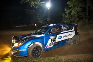 Travis Pastrana blasting throught the forest at night Ojibwe Forest Rally