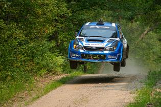 Travis Pastrana catching air at the Ojibwe Forest Rally