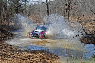 Travis Pastrana stream-crossing 100 Acre Wood Rally 2014