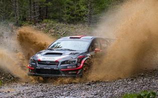 Travis Pastrana blasts through the water at the Olympus Rally.