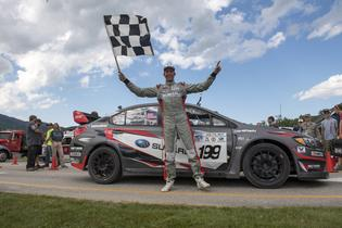 Travis Pastrana celebrates victory at Mt Washington Hillclimb. Photo Credit: Lars Gange / Subaru Rally Team USA
