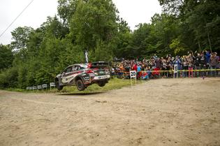 Travis Pastrana jumps past a spectator point at the Ojibwe Forests Rally