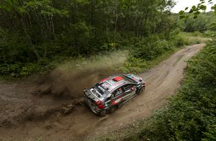 Travis Pastrana navigates the muddy conditions at the Ojibwe Forest Rally