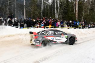 Travis Pastrana races past a spectator point at Rallye Perce Neige 2017