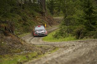 Travis Pastrana slides his Subaru through the forest at the Olympus Rally.
