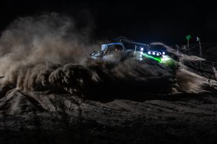 The Subaru Crosstrek Desert Racer kicks up dust during the night as it nears the Baja 500 finish line.
